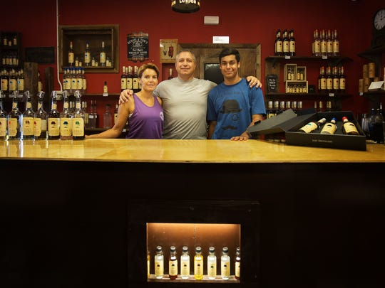 Thomas List, center, along with his wife, Renate, are owners of the List Distillery in Fort Myers.  Their son Le Roy works at the disillery as well.