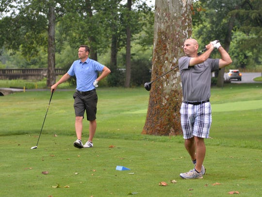 From left, Ryan Weaber and Stu Hanford play the first