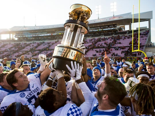 UK players lift the Governor's Cup after their upset 2016 win.