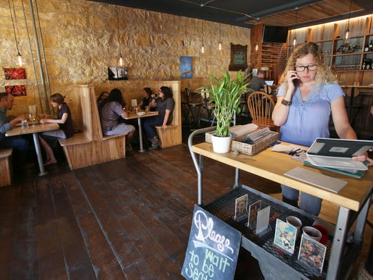 In this June 1, 2017 photo, Ruthie Zahm takes a call at the Driftless Cafe, which she owns with her husband Luke, in Viroqua. This small town about two hours northwest of Madison is helping put Wisconsin on the culinary map.