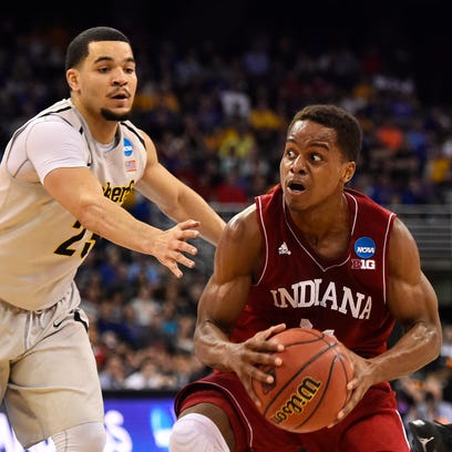 Mar 20, 2015; Omaha, NE, USA; Indiana Hoosiers guard Yogi Ferrell (11) drives past Wichita State Shockers guard Fred VanVleet (23) during the first half in the second round of the 2015 NCAA Tournament at CenturyLink Center. Mandatory Credit: Jasen Vinlove-USA TODAY Sports