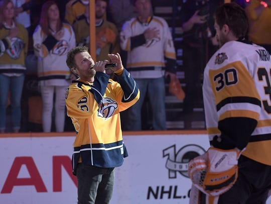 Dierks Bentley sings the national anthem before Game
