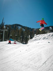 This undated photo provided by Taos Ski Valley shows a snowboarder catching air at the resort in Taos. Taos Ski Valley is investing $300 million in the resort to update and expand its facilities. Improvements include a new lift to Kachina Peak, enhanced snowmaking, and modernized hotel, dining and shopping options.