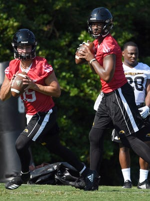 Southern Miss quarterback Jack Abraham, left, and Kwadra Griggs, right, prepare to throw the ball to their teammates during the first day of fall camp on Friday, August 3, 2018. Southern Miss' first game will be held in Hattiesburg on Saturday, September 1 against Jackson State.