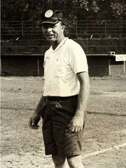 Bubba Brasher is shown in bare feet and shorts as he was on a baseball field many years ago preparing for a Dixie Boys Baseball tournament.