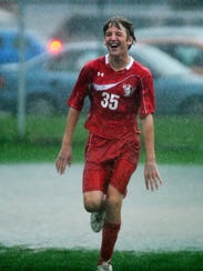 Seth Bilbie dances in the rain following a win over