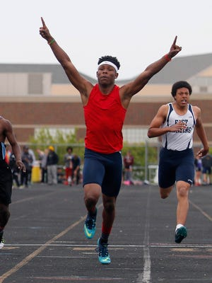 Everett's Marice Allen celebrates as he wins the 200 meter dash May 20, 2016, in Holt.