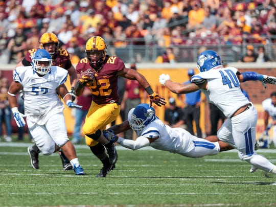 Minnesota Golden Gophers running back Kobe McCrary (22) rushes against Indiana State Sycamores linebacker Cedric Doxy (7) during the second quarter at TCF Bank Stadium.