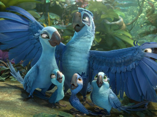 "Blu (Jesse Eisenberg), Jewel (Anne Hathaway) and their three kids arrive in the Amazon in a scene from the motion picture ""Rio 2."""