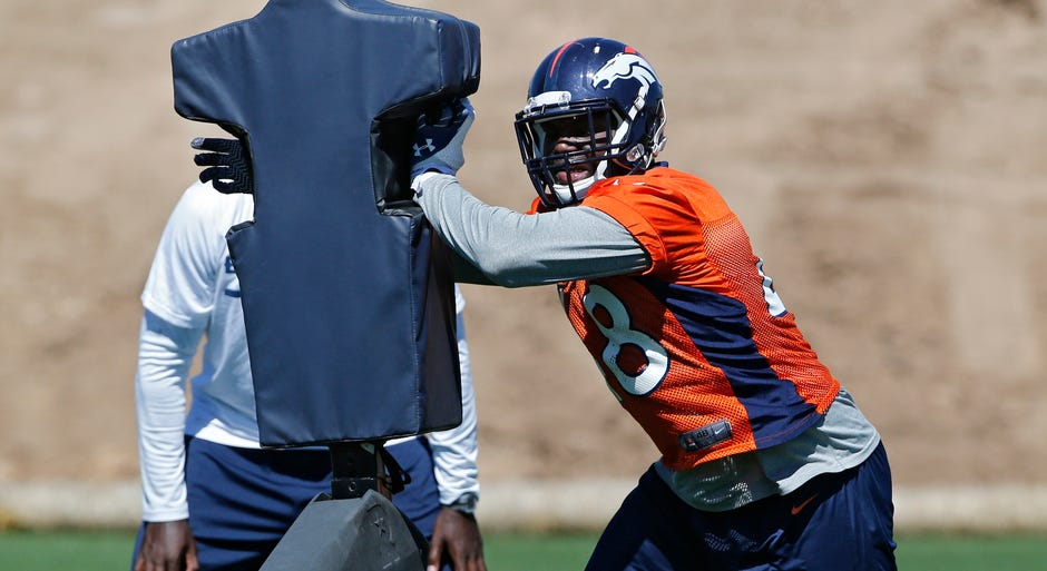 Denver Broncos Shaquil Barrett, a former CSU linebacker, hits a blocking dummy during an NFL football organized team practice at the Broncos training facility in Englewood, Colo., on Wednesday, May 28, 2014. (AP Photo/Ed Andrieski)