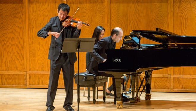 """Violinist Benjamin Sung, left, and pianist David Kalhous perform the second recital in their series, """"Beethoven: The Complete Works for Violin and Piano"""" at Florida State University."""