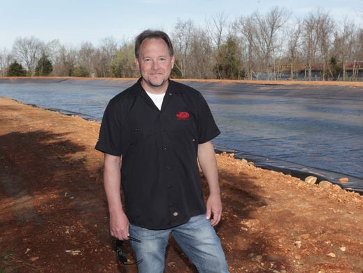Greg Mustain has built a 5-6-acre lake behind his business, Ski Shack, on South Campbell where heÕll have an overhead cable system that pulls wakeboarders across the lake, both for lessons and also as a pay-to-play attraction.