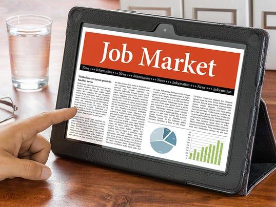 Tablet computer on a desk - Job Market