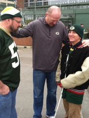 Former Green Bay Packers punter Josh Bidwell, middle,
