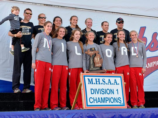 The Milford girls cross country team steps to the podium after win their first Division 1 title in school history.