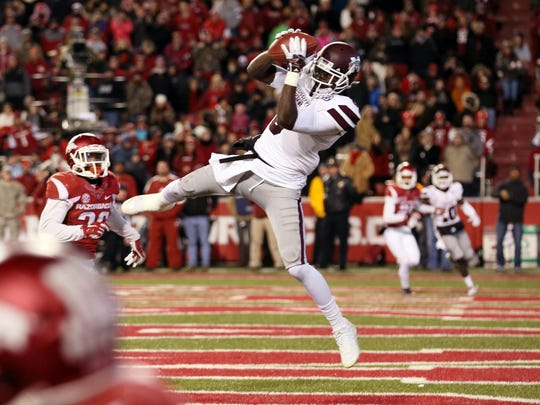Nov 21, 2015; Fayetteville, AR, USA; Mississippi State Bulldogs wide receiver Fred Brown (5) catches a pass for a touchdown in the first half against the Arkansas Razorbacks at Donald W. Reynolds Razorback Stadium. Mandatory Credit: Nelson Chenault-USA TODAY Sports