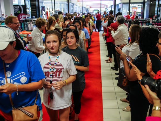 More than 1300 people walk down a red carpet at the