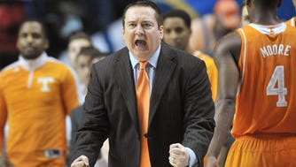 Donnie Tyndall shouts instructions to his team during Tennessee's game against Arkansas in the SEC tournament on March 13, 2015.