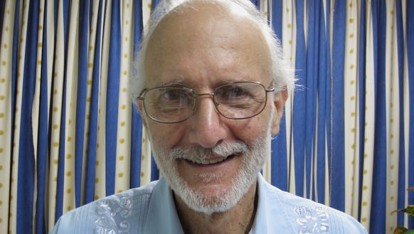 Alan Gross poses for a photo during a visit by Rabbi