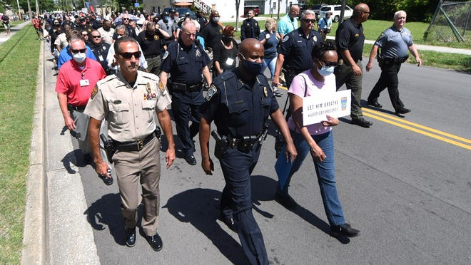 Wilmington Interim Police Chief Donny Williams leads a peace march down Sixth  Street from the Wilmington Police Department headquarters to the 1898 Memorial Park in Wilmington, N.C., Tuesday, June 3, 2020.