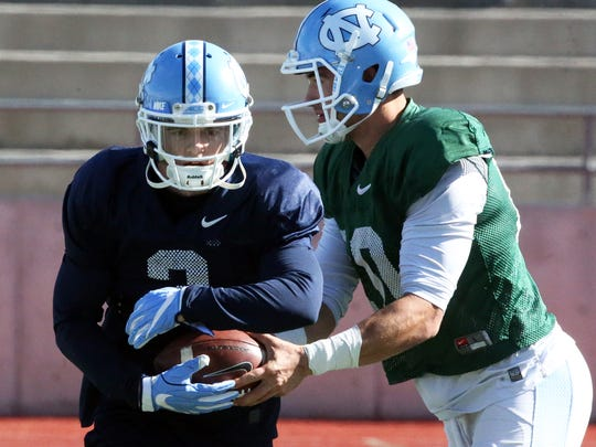 North Carolina quarterback Mitch Trubisky, right, hands