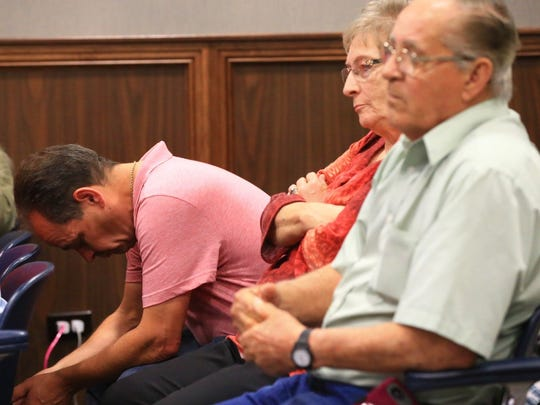 Family members of Clyde Leonard, who was fatally stabbed last year, react after defendant Dimalier Jeremias Rosado is found not guilty of murder on Wednesday, April 5, 2017, at the Nueces County Courthouse.