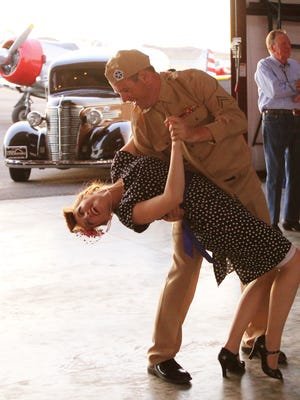A couple practices a dance step during the 2014 Hangar Dance event at Western Sky Aviation Warbird Museum, north of the St. George Regional Airport. The annual fundraiser that combines social dance, a live jazz band and World War II era music will take place this year on May 13.