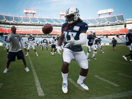 Titans safety Johnathan Cyprien (37) warms up before