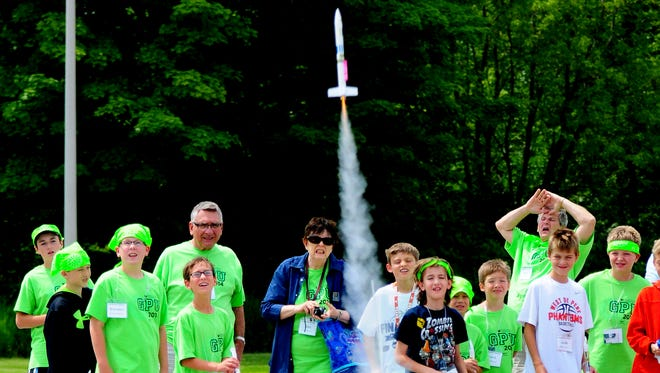 Grandparents and grandchildren launch rockets they built Friday during the Grandparents University program at the University of Wisconsin-Green Bay.