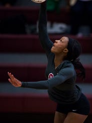 Westside's Trinity Williams spikes the ball at the