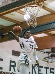New Haven sophomore Romeo Weems dunks the ball during