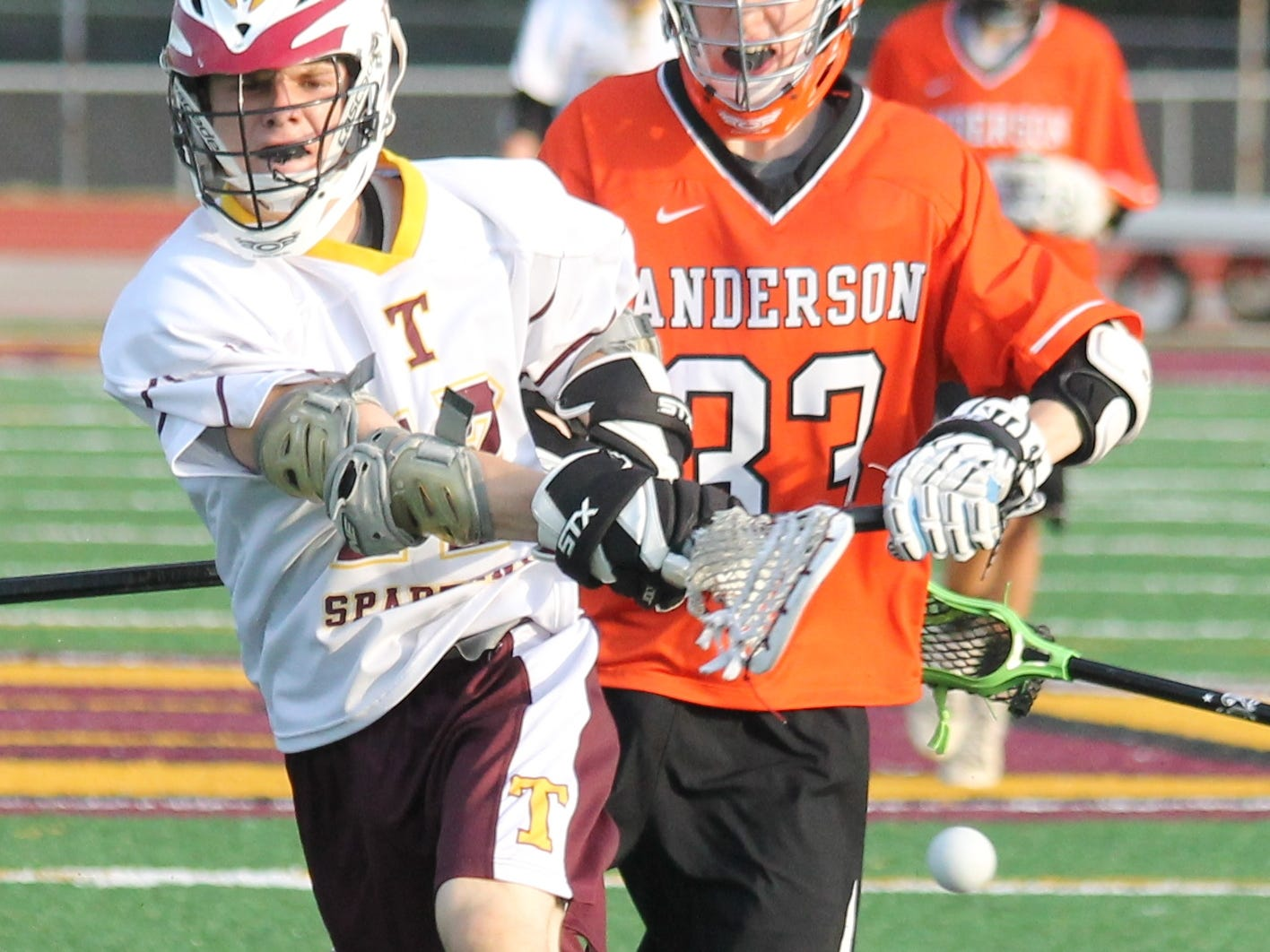 Turpin sophomore Nate Hooper whips a shot on goal and scores in the Spartans' 15-9 win against Anderson.