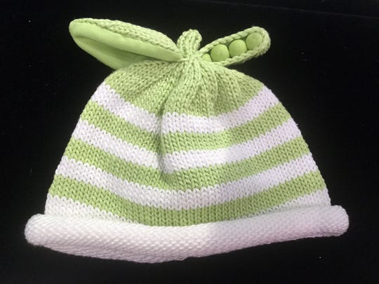 For your sweet pea, a Florida-designed and knit baby cap, $20, that fits 0 to 4 years, by Margareta Horn Design, of Lakewood Ranch. It's one of a number of styles at the Naples Art Association gift shop.