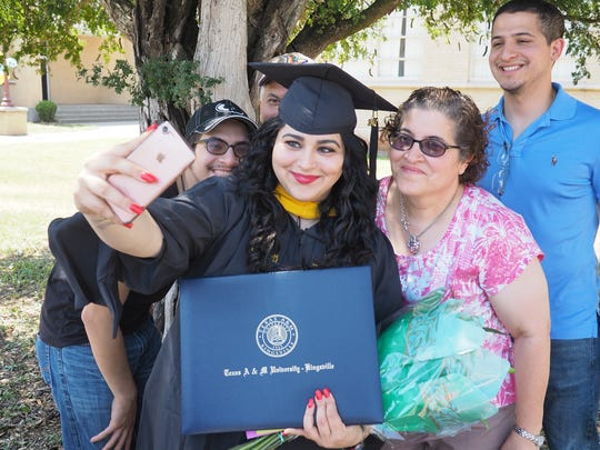 Esmeralda Cantu Ramirez takes a selfie with her family following the first of four commencement ceremonies Friday, May 12, 2017, and Saturday, May 13, 2017, at Texas A&M University-Kingsville. She received her master's degree in bilingual education.