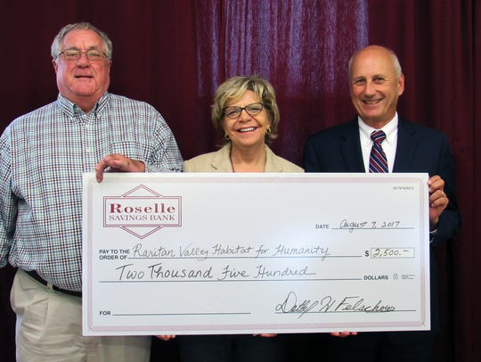 Accepting aRoselle Savings Bank donation presented