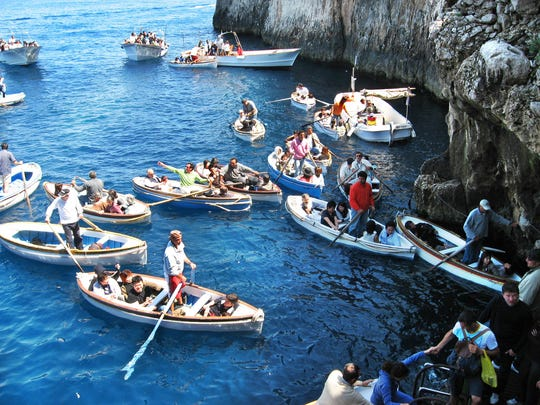 Boats jockey for position as they get ready to enter the Blue Grotto in the island of Capri in southern Italy.