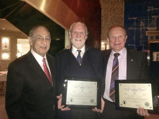 Kean University President Dawood Farahi, Ph.D., stands with former Governor Jon Corzine and New Jersey Senator Raymond J. Lesniak, who received certificates of appreciation from the Kean Human Rights Institute for their roles in the abolition of the state's death penalty 10 years ago.
