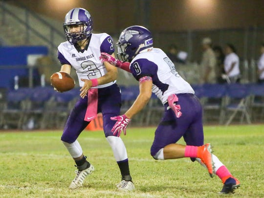 Hunter Brooks hands off the ball to Kaleb Welmas. Shadow Hills 32, Indio 13 -- The Mayor's Cup will stay with the Knights!