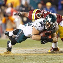 Eagles tight end Zach Ertz catches a pass last Sunday as Redskins inside linebacker Perry Riley closes in.