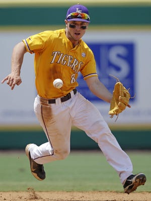 Alex Bregman has already proven to be a talented shortstop, and he believes he can play that position in the majors. LSU infielder Alex Bregman (8) fields a grounder single by UNC Wilmington's Robbie Thorburn in the eighth inning of a game at the Baton Rouge Regional of the NCAA college baseball tournament in Baton Rouge, La., Monday, June 1, 2015. LSU won 2-0 to win the tournament and advance to the super regionals.