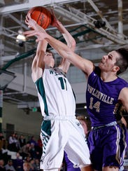 Williamston's Trevor Fortin, left, shoots against Fowlerville's
