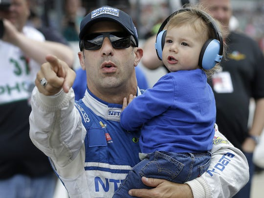 IndyCar driver Tony Kanaan (10) and son Deco following his qualifying run for the 100th running of the Indianapolis 500 Saturday, May 21, 2016, morning at the Indianapolis Motor Speedway.