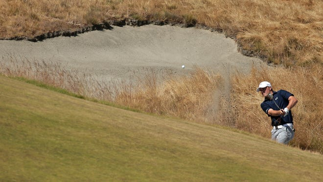 Jordan Spieth hits out of the bunker on the 18th hole during the second round of the U.S. Open golf tournament at Chambers Bay on Friday, June 19, 2015 in University Place, Wash.