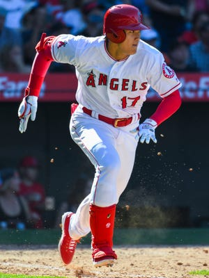 Los Angeles Angels DH Shohei Ohtani (17) sprints to first in the 8th inning against the San Francisco Giants at Angel Stadium of Anaheim. Ohtani did not beat the throw for the second out in the inning. The Angels lost 4-2 to the Giants.