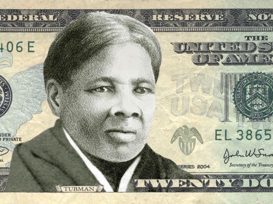 A model of a $20 bill with Harriet Tubman.