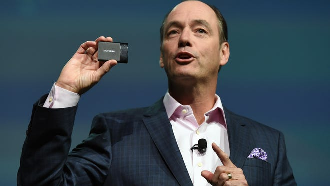 Samsung Electronics America Executive President and COO Tim Baxter displays an SSD T1 portable solid state drive at a press event for Samsung at the Mandalay Bay Convention Center for the 2015 International CES on Jan. 5, 2015, in Las Vegas.