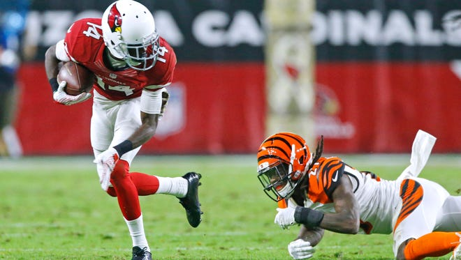 Arizona Cardinals wide receiver J.J. Nelson breaks free for a first down in the fourth quarter against the Cincinnati Bengals in their  NFL game on Sunday, Nov. 22, 2015, in Glendale.