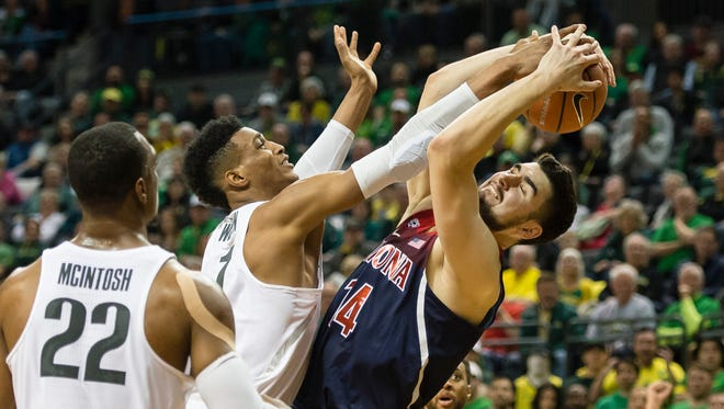 Feb 24, 2018; Eugene, OR, USA; Arizona Wildcats center Dusan Ristic (14) grabs a rebound away from Oregon Ducks forward Kenny Wooten (1) during the first half at Matthew Knight Arena. Mandatory Credit: Troy Wayrynen-USA TODAY Sports