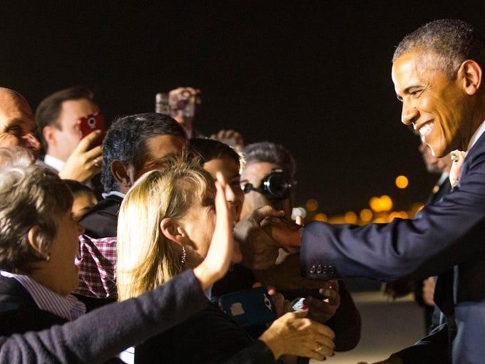 President Barack Obama greets supporters after arriving