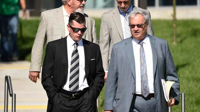 John Bowlen, left, 29-year-old son of Denver Broncos team owner Pat Bowlen, walks out of court, August 14, 2015. Bowlen was in Arapahoe County Court a pretrial conference in a domestic violence case.